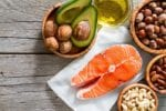 healthy fat sources on wooden table